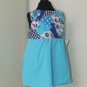 Pinafore styled with front opening